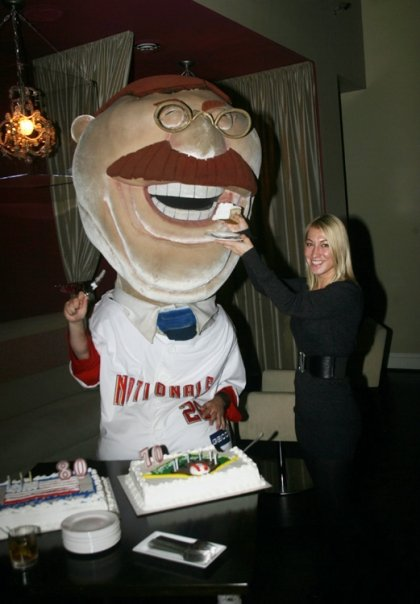 Nationals' racing president Teddy Roosevelt gets the first slice of his 150th birthday cake on Monday night at DC's Hudson Restaurant.