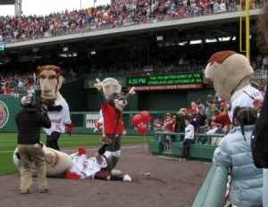 That Cat tackles Thomas Jefferson during the opening day presidents race at Nationals Park