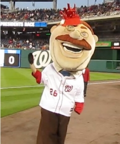 Nationals racing president Teddy Roosevelt wears a royal wedding guest hat