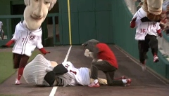 Racing president Abe Lincoln leaps over That Cat to take the presidents race