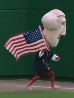 Nationals Presidents Race - Thomas Jefferson carries the flag on Independence Day