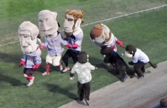 Harrisburg Senators racing monkey Steve tackles Washington Nationals president Teddy Roosevelt at the Harrisburg Senators' Metro Bank Park