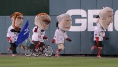 Washington Nationals racing president Teddy Roosevelt takes the GEICO Gecko along on a ride for the presidents race at Nationals Park