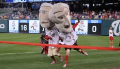 Washington Nationals racing presidents George Washington and Thomas Jefferson fight it out to the finish line at Nationals Park