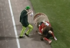 Teddy Roosevelt is tackled by a Leprechaun