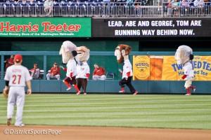 Teddy Roosevelt looks for the Space Shuttle during the Presidents Race - photo by Cheryl Nichols
