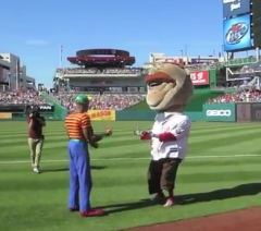 Teddy Roosevelt distracted by Juggler during presidents race at Nationals Park