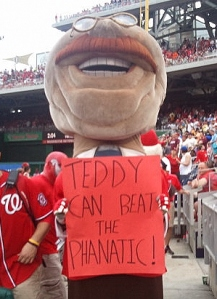 Washington Nationals racing president Teddy Roosevelt challenges the Phillies Phanatic