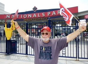 In response to Davey Johnson, Rubber Chicken Man Hugh Kaufman Sacrifices a chicken at Washington Nationals Park