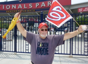 Washington Nationals Rubber Chicken Man Hugh Kaufman displays his Chicken Mode T-Shirt