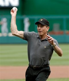 David Petraeus throws out the first pitch at Nationals Park on Military Appreciation Day September 9, 2012 (AP)