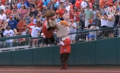 Abe Lincoln leaps from the stands to tackle Teddy Roosevelt in the Washington Nationals Presidents Race