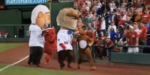 Kool Aid Man hands off to Bullee the Moose in the anchor leg of the Nationals presidents race