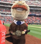 Teddy Roosevelt holds up the Presidents Race Championship Belt
