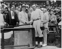 Calvin Coolidge poses with Walter Johnson at Griffith Stadium