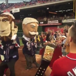 WWE wrestler The Miz shines the belt and temporarily blinds the Nationals racing presidents